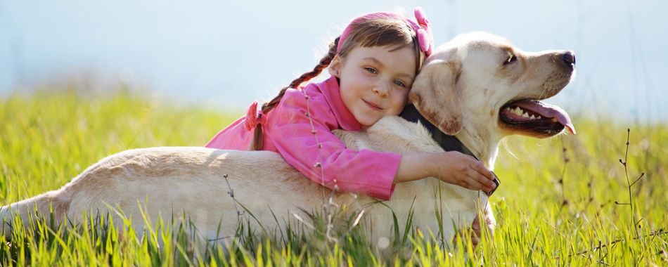happy girl spending time with dog that is allergic to chicken